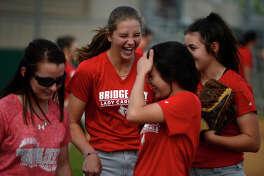 Bridge City's Kassidy Wilbur, center, jokes with her teammates during practice on Wednesday.  Photo taken Wednesday 4/6/16 Ryan Pelham/The Enterprise