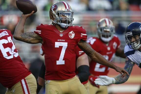 San Francisco 49ers quarterback Colin Kaepernick (7) throws against the Seattle Seahawks at Levi's Stadium in Santa Clara, Calif., on January 1, 2017. The Seahawks' Pete Carroll says the free agency door is remains open with Kaepernick. (Nhat V. Meyer/Bay Area News Group/TNS)