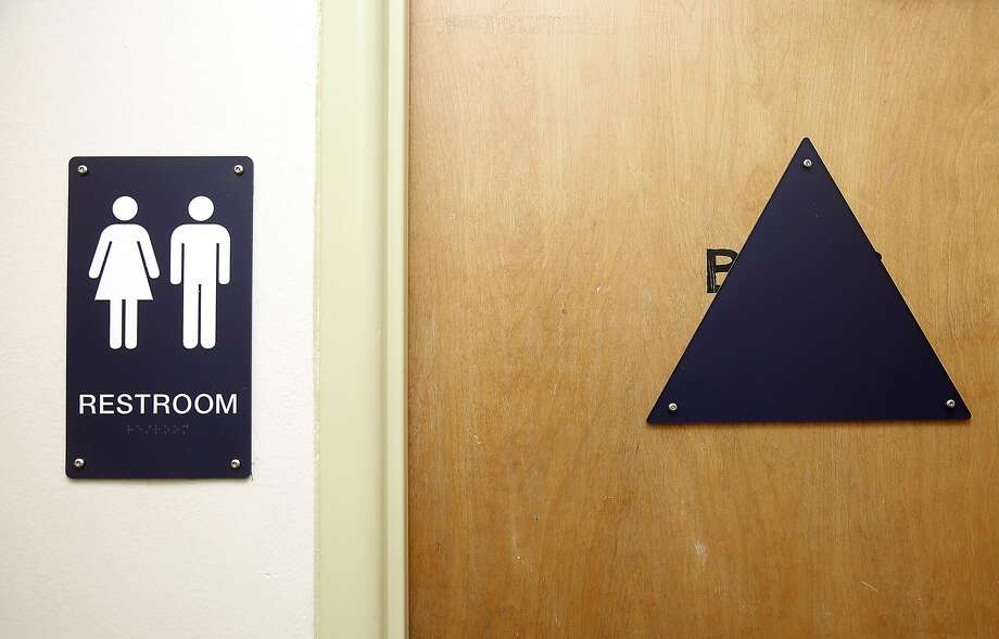 The sign is only the start; what about the urinals? Photo: Liz Hafalia, The Chronicle