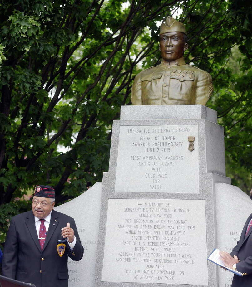 James Dandles, the district president of the 369th Veterans Association (Henry JohnsonÕs Regiment) stands near the Henry Johnson statue at an event to mark the first annual Henry Johnson Day on Monday, June 5, 2017, in Albany, N.Y. A replica Medal of Honor was added to the Henry Johnson Statue, which was unveiled on Monday.  Dandles was also awarded the first Henry Johnson Award for Distinguished Community Service.  (Paul Buckowski / Times Union) Photo: PAUL BUCKOWSKI, Albany Times Union / 40040626A