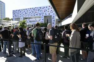 Attendees wait in line outside of the McEnery Convention Center before the start of the Apple Worldwide Developers Conference (WWDC) in San Jose, California, U.S., on Monday, June 5, 2017. The conference aims to inspire developers from around the world to turn their passions into the next great innovations and apps that customers use every day across iPhone, iPad, Apple Watch, Apple TV and Mac. Photographer: Michael Short/Bloomberg