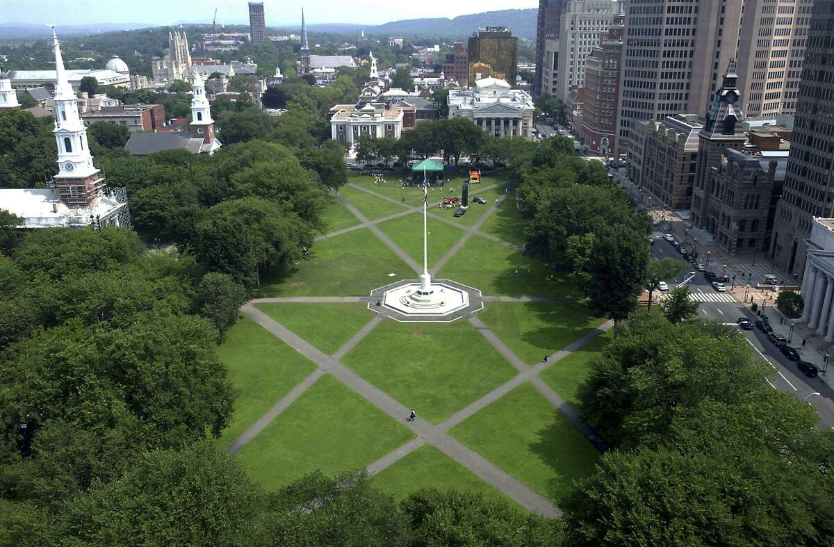 The New Haven Green is shown from the roof of 900 Chapel Street in New Haven. Hearst has announced the acquisition of the New Haven Register, Connecticut Magazine and other daily and weekly papers, further expanding its coverage of Connecticut.