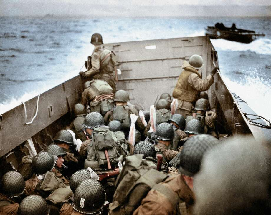 A Landing Craft, Vehicle, Personnel (LCVP) is approaching Omaha Beach, Normandy, France, 6th June 1944. To the right is another LCVP. The soldiers are protecting their weapons with Pliofilm covers against the wetness. These U.S. Army infantry men are amongst the first to attack the German defenses probably near Ruquet ? Saint Laurent sur Mer. Photo: Robert F. Sargent, U.S. Coast Guard (USCG). Normandy, France. Photo:  (Photo By Galerie Bilderwelt/Getty Images)