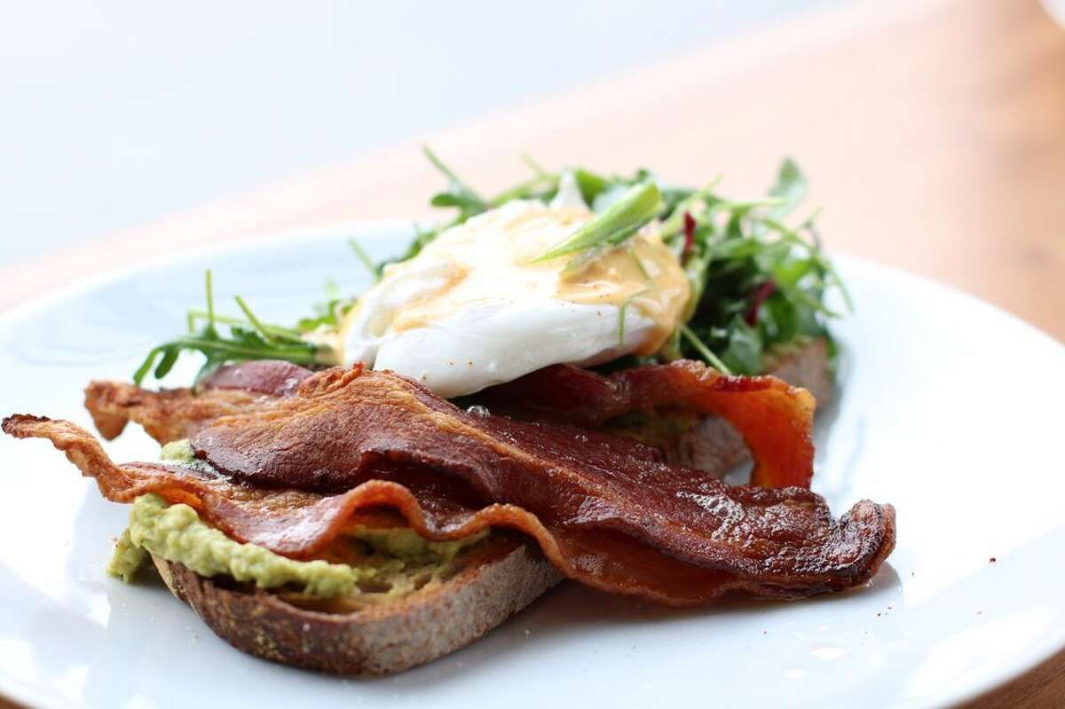 OAKLAND: AVOCADO TOAST Of course, we have to compare prices on the all-important Avocado Toast Index. The bacon, poached egg and avocado sandwich at Plenty in Oakland costs $7.