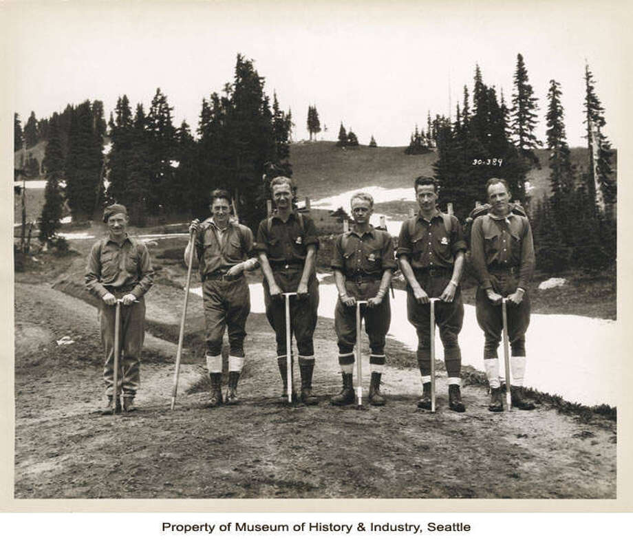 """""""Charles Browne became a National Park Service Ranger around 1928, working first in Mount Rainier National Park, and later in Olympic National Park. After 37 years of service, Browne retired from the National Park Service in 1965. Ranger Browne, at far left, is shown here with a party of climbers, perhaps other rangers. The men hold ice axes, and are probably about to begin a climb."""" -MOHAI. Photo courtesy MOHAI, Charles Browne Mount Rainier Park Ranger Photographs, image number 2009.16.43. Photo: MOHAI"""