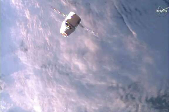 A SpaceX Dragon approaches the International Space Station on Monday, June 5, 2017, making an unprecedented second trip to the orbiting outpost. The Dragon supply ship, recycled following a 2014 flight, was launched from Florida on Saturday. (NASA TV via AP)