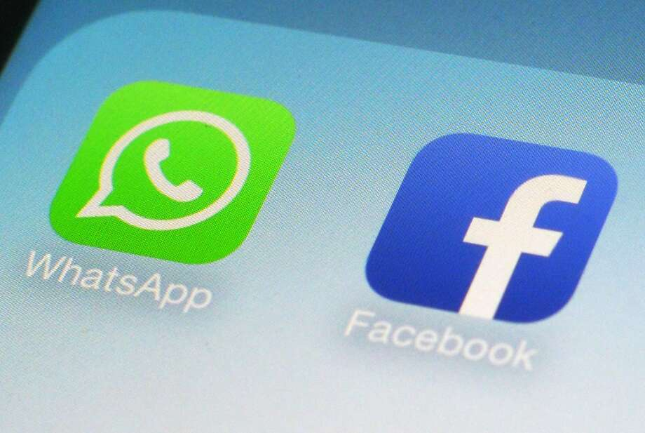 FILE - This Feb. 19, 2014, file photo, shows WhatsApp and Facebook app icons on a smartphone in New York. Global messaging service WhatsApp says it will start sharing the phone numbers of its users with Facebook, its parent company. That means WhatsApp users could soon start seeing more targeted ads on Facebook, although not on the messaging service itself. (AP Photo/Patrick Sison, File) Photo: Patrick Sison, Associated Press