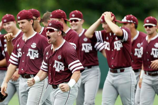 Texas A&M's Logan Foster (5) celebrates with teammates after pulling out a 4-3 win over the Houston Cougars during Game 6 of an NCAA Regional baseball game at Schroeder Park, in Houston, Monday, June, 5, 2017.