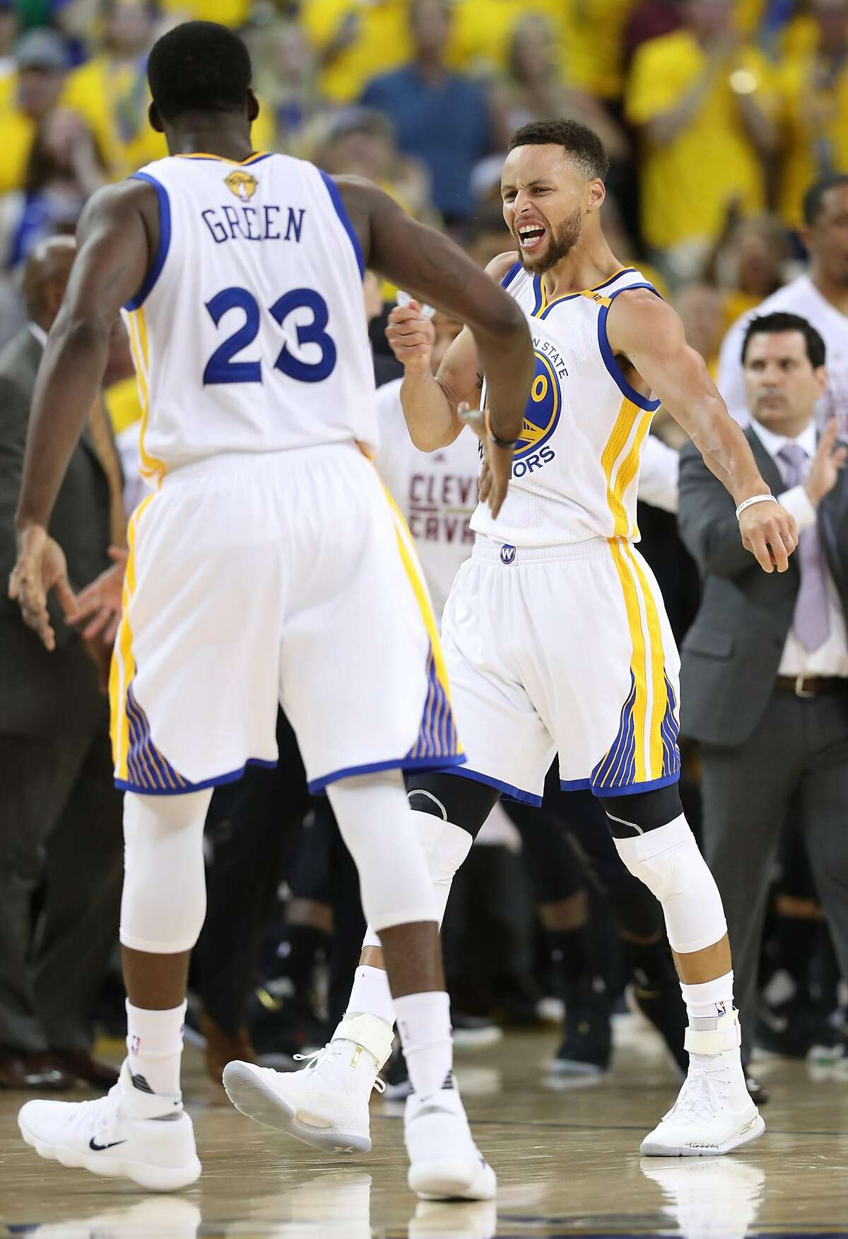 Golden State Warriors' Stephen Curry reacts to his drive and lay up against Cleveland Cavaliers' LeBron James in 3rd quarter of Warriors' 132-113 win in Game 2 of NBA Finals at Oracle Arena in Oakland, Calif., on Sunday, June 4, 2017.