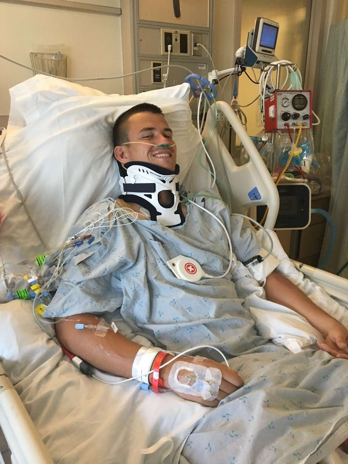 Robert Paylor smiles for the camera after suffering serious injuries during a May 6 rugby game.
