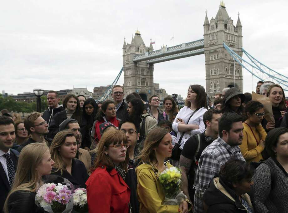 People queue to lay flowers after a vigil for victims of Saturday's attack in London Bridge, at Potter's Field Park in London, Monday, June 5, 2017. Police arrested several people and are widening their investigation after a series of attacks described as terrorism killed several people and injured more than 40 others in the heart of London on Saturday. Photo: Tim Ireland / Associated Press / Copyright 2017 The Associated Press. All rights reserved.