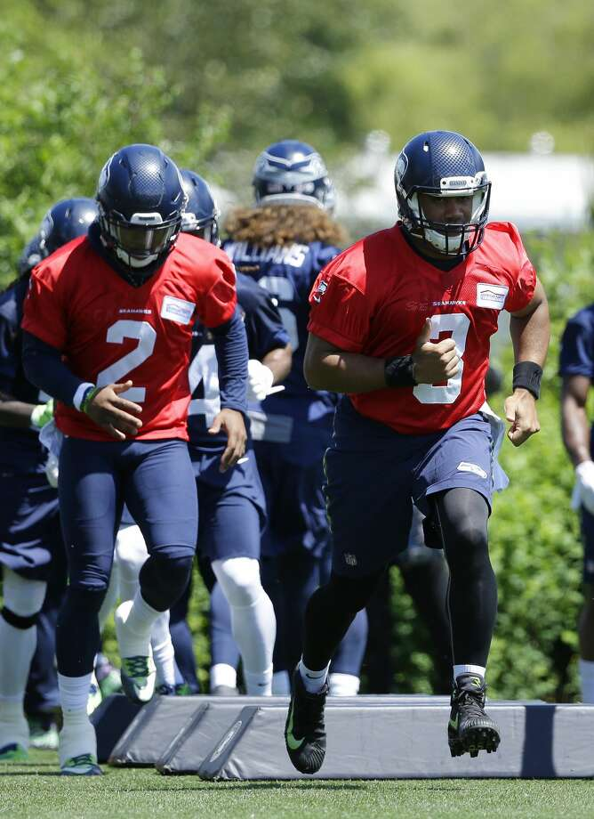 seattle seahawks quarterback russell wilson right and backup quarterback trevone boykin left