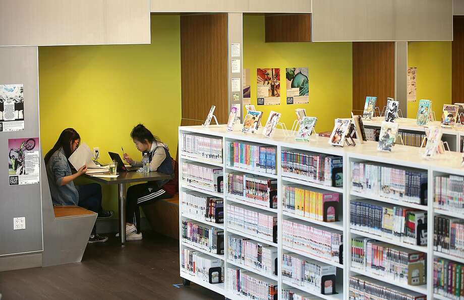 High school students Jiamei Zhou (left) and Winnie Li, both 16, buckle down in a work space at the San Francisco Public Library's teen center, the Mix. Photo: Liz Hafalia, The Chronicle