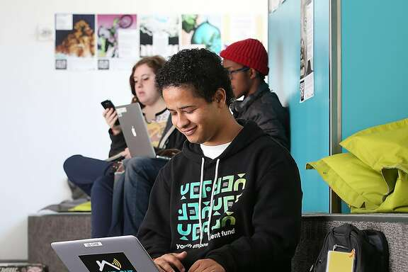 Chaz Bell, 17 years old, tries out a computer from Tech'd Out looking up the Paris agreement at The Mix at SFPL on Monday, June 5, 2017, in San Francisco, Calif.  Two years ago, San Francisco rolled out free wifi in public spaces in 30 parks, plazas and recreation centers with new electronics coming soon for SF library's Tech'd Out program, which will lend laptops and mifi's to bay area patrons.