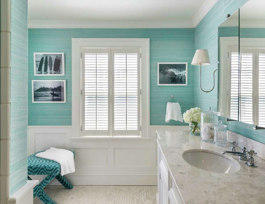 A textured wall covering in ocean blue/green shades brightens a bathroom design. Photo: Nat Rea, HONS / Kate Jackson Interior Design