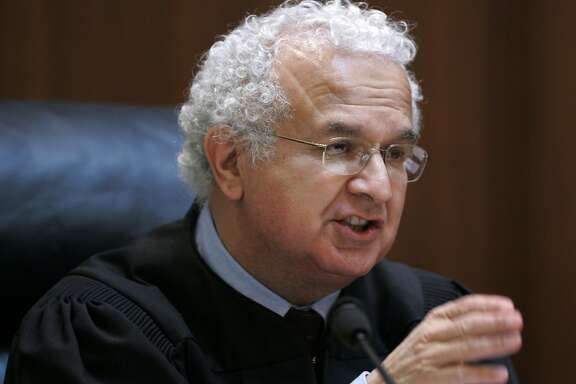 This March 4, 2008 file photo shows California Supreme Court Associate Justice Carlos R. Moreno in San Francisco. A source tells The Associated Press, Wednesday, May 13, 2009, that President Barack Obama is considering Moreno and more than five other people as nominees for the Supreme Court. (AP Photo/Paul Sakuma, pool)
