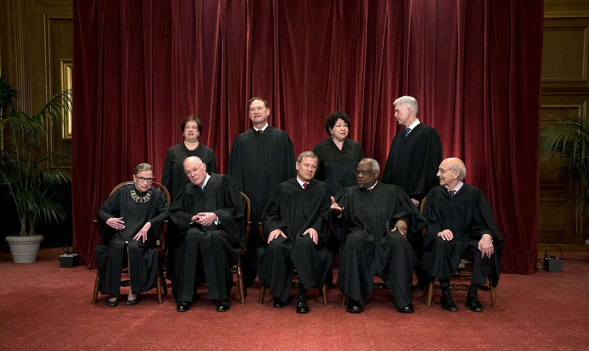 The justices of the U.S. Supreme Court sit for a group portrait in Washington, June 1, 2017. The fight over President Donald Trump�s travel ban reached the Supreme Court late Thursday night, in the form of three urgent requests from the Justice Department. Front row, from left: Associate Justice Ruth Bader Ginsburg, Associate Justice Anthony Kennedy, Chief Justice John Roberts, Associate Justice Clarence Thomas, and Associate Justice Stephen Breyer. Back row, from left: Associate Justice Elena Kagan, Associate Justice Samuel Alito, Associate Justice Sonia Sotomayor and Associate Justice Neil Gorsuch. (Doug Mills/The New York Times)