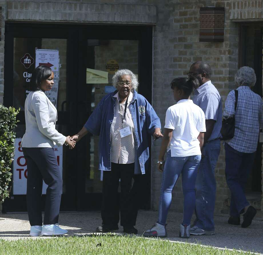 San Antonio mayor Ivy Taylor (left) enters the Claude Black Center Monday June 5, 2017 before casting her ballot during early voting. Taylor was accompanied by her daughter Morgan Taylor,13, and her husband Rodney Taylor. Taylor said she voted for herself. Photo: John Davenport, STAFF / San Antonio Express-News / ©John Davenport/San Antonio Express-News