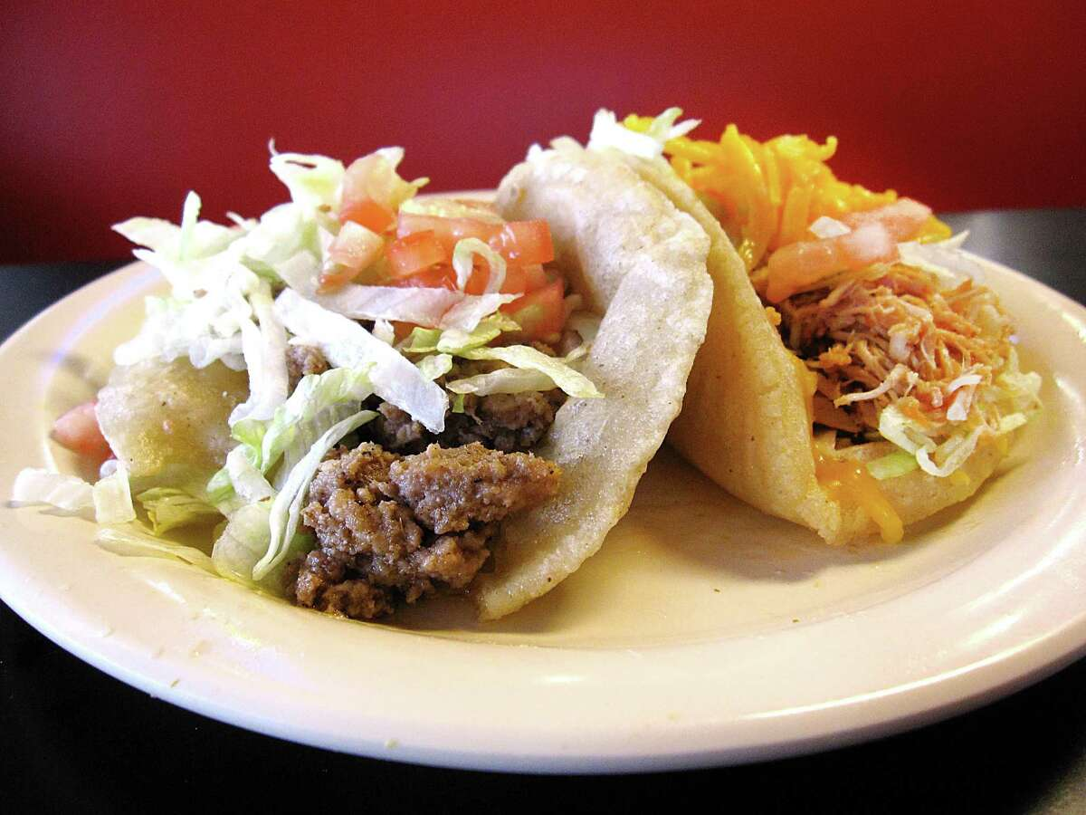 Beef picadillo puffy taco, left, and a chicken puffy taco from from Oscar's Taco House.