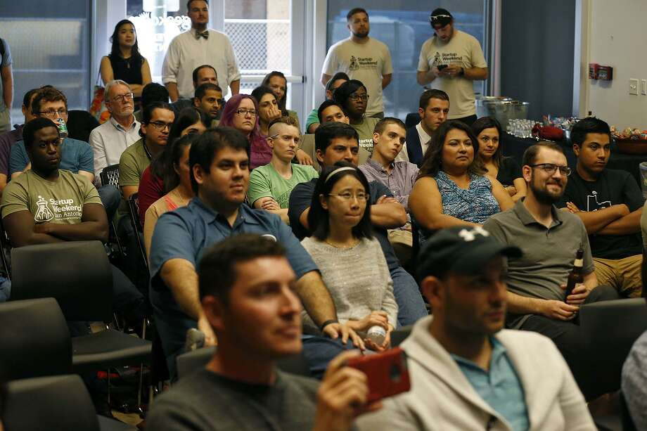 File Photo - Startup Weekend attendees watch others make their final idea pitch on June 4, 2017 at Geekdom. The co-working space Geekdom announced Tuesday the launch of a fund to provide individuals and startups with initial seed funding. Photo: Edward A. Ornelas /San Antonio Express-News / © 2017 San Antonio Express-News