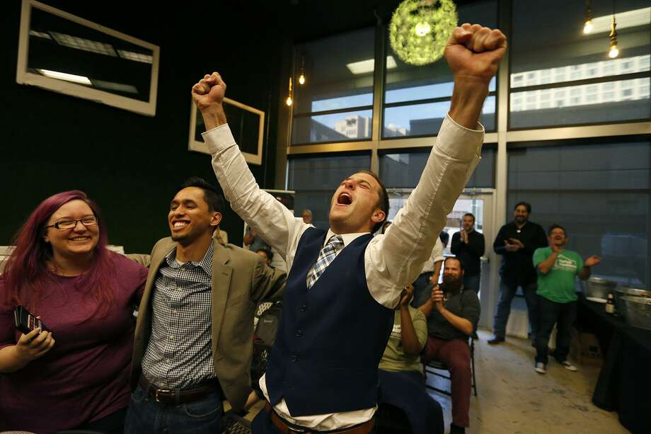 Stefanie Young (from left), Ramil Rodriguez, and Marshall Uhlig, of CareerMatch, celebrate their first place win during Startup Weekend held Sunday June 4, 2017 at Geekdom. Photo: Edward A. Ornelas, Staff / San Antonio Express-News / © 2017 San Antonio Express-News
