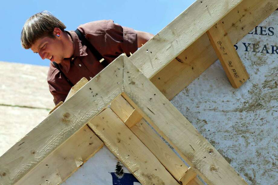 A builder works Monday on the roof of a home under construction in Jackson Township, Pa. U.S. labor costs rose at a 2.2 percent rate in the first quarter. Photo: Keith Srakocic, STF / Copyright 2017 The Associated Press. All rights reserved.
