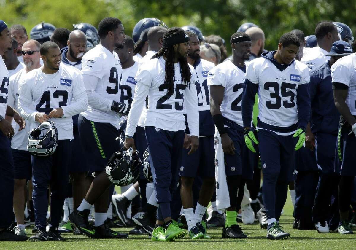 Seahawks cornerback Richard Sherman (25) walks with teammates following practice, Friday, June 2, 2017, in Renton.