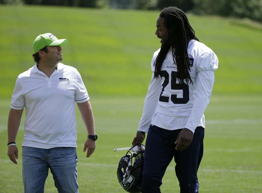 Seattle Seahawks cornerback Richard Sherman, right, laughs as he walks with general manager John Schneider, left, following NFL football practice, Friday, June 2, 2017, in Renton, Wash. (AP Photo/Ted S. Warren) Photo: Ted S. Warren/AP