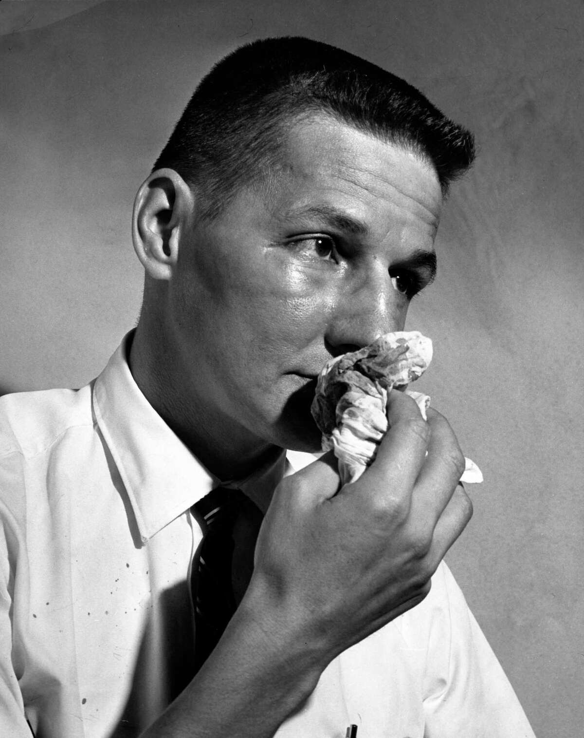 09/08/1964 - Houston Post reporter Gene Goltz wipes his bloody nose after being assaulted by Pasadena police and fire commissioner Quincy James outside the Harris County Grand Jury room.
