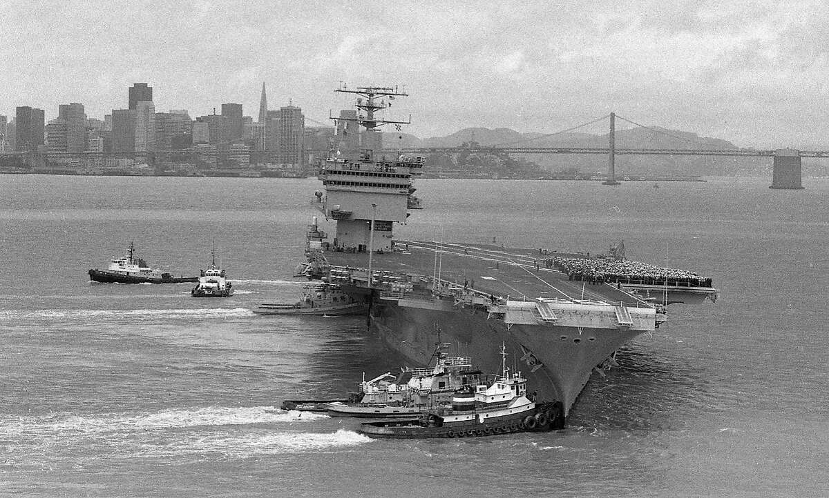 U.S.S. Enterprise enters San Francisco Bay and gets stuck on a sand bar off of Alameda .. Tugboats help the Navy ship get dislodged Photos shot from helicopter 04/28/1983