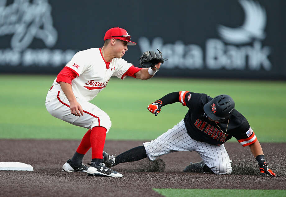 Texas Tech's Orlando Garcia (2) tries to tag out Sam Houston State's Robie Rojas (9) during an NCAA college baseball regional tournament game in Lubbock, Texas, Sunday, June 4, 2017. (Brad Tollefson/Lubbock Avalanche-Journal via AP)