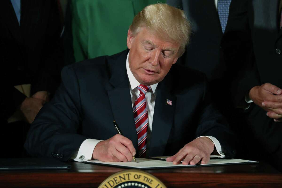 President Donald Trump signs a decision memo and a letter to members of Congress outlining the principles of his plan to privatize the nation's air traffic control system in the East Room at the White House, Monday, June 5, 2017, in Washington. (AP Photo/Andrew Harnik) ORG XMIT: DCAH104