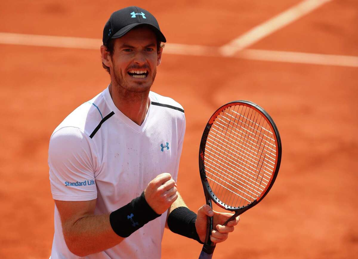 PARIS, FRANCE - JUNE 05: Andy Murray of Great Britain celebrates victory during the men's singles fourth round match against Karen Khachanov of Russia on day nine of the 2017 French Open at Roland Garros on June 5, 2017 in Paris, France. (Photo by Clive Brunskill/Getty Images) ORG XMIT: 687104767