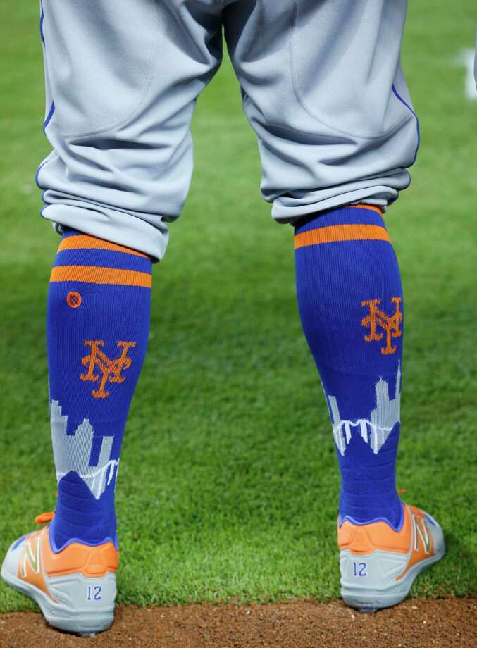 In this Saturday, April 15, 2017, photo, New York Mets center fielder Juan Lagares' socks are shown before the start of a baseball game against the Miami Marlins in Miami. This season, baseball has put footwear at the forefront, working with a new provider to create custom sock looks for almost all its teams, as well as special occasion designs for events like Mother's Day and the upcoming All-Star Game. (AP Photo/Wilfredo Lee) ORG XMIT: NY164 Photo: Wilfredo Lee / Copyright 2017 The Associated Press. All rights reserved.