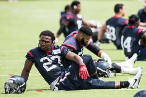 D'Onta Foreman stretches during OTAs in May at the Methodist Training Center, The Texans' third-round pick out of the University of Texas was arrested in Austin on Sunday morning and released after posting bond.