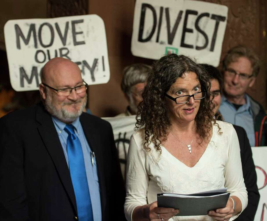 Rosendale, N.Y. town council member Jen Metzger, right, is joined by elected officials from across New York state during a press conference to release a letter from more than 200 elected officials across the state asking Comptroller DiNapoli to drop the $5 billion that the Common Retirement Fund invests in fossil fuels. Immediately following on President TrumpOs decision to exit the Paris Climate Agreement, Local elected officials are rallying to defend action on climate change. Governor CuomoOs strong commitment to climate action and NYC Mayor Bill De BlasioOs announcement that New York will continue to honor the Paris agreement confirms that the imperative for bold climate action now sits in the hands of state and local elected officials. Monday June 5, 2017 at the State Capitol in Albany, N.Y.  (Skip Dickstein/Times Union) Photo: SKIP DICKSTEIN / 40040688A