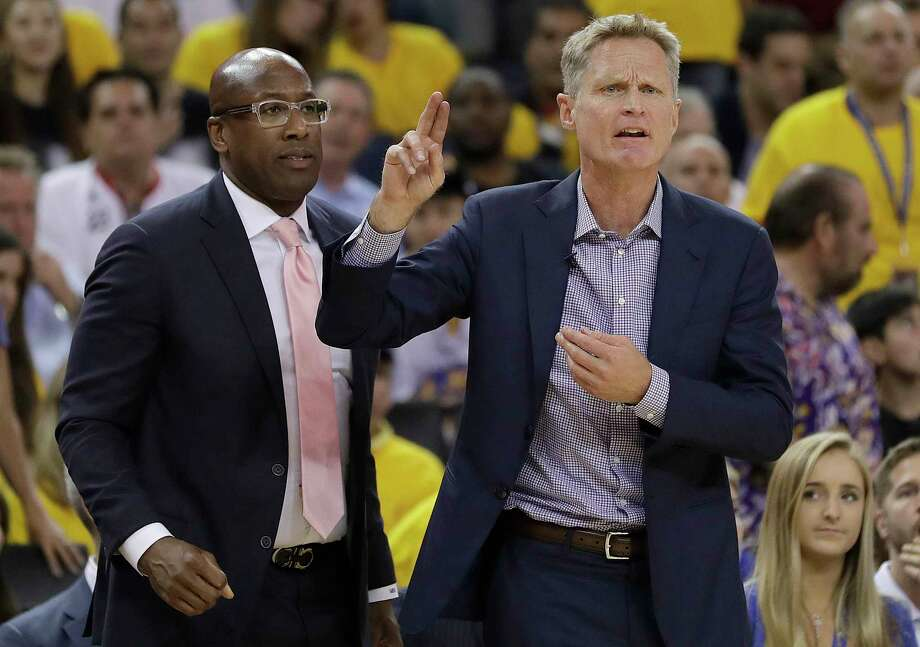 Golden State Warriors head coach Steve Kerr, right, gestures next to interim head coach Mike Brown during the first half of Game 2 of basketball's NBA Finals against the Cleveland Cavaliers in Oakland, Calif., Sunday, June 4, 2017. (AP Photo/Marcio Jose Sanchez) ORG XMIT: OAS131 Photo: Marcio Jose Sanchez / Copyright 2017 The Associated Press. All rights reserved.