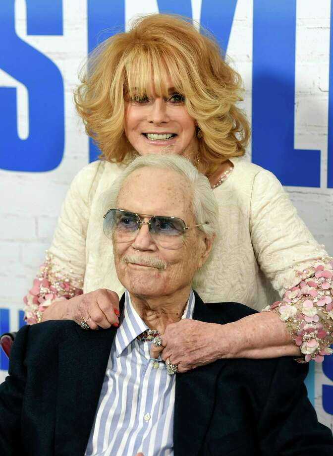 "FILE - In this March 30, 2017 file photo, actress Ann-Margret and her husband Roger Smith appear at the world premiere of ""Going in Style"" in New York. Smith, star of the ""77 Sunset Strip,"" and husband of actress Ann-Margret, died at a Los Angeles hospital on Sunday, June 4, at age 84. (Photo by Evan Agostini/Invision/AP, File) ORG XMIT: NYET142 Photo: Evan Agostini / 2017 Invision"