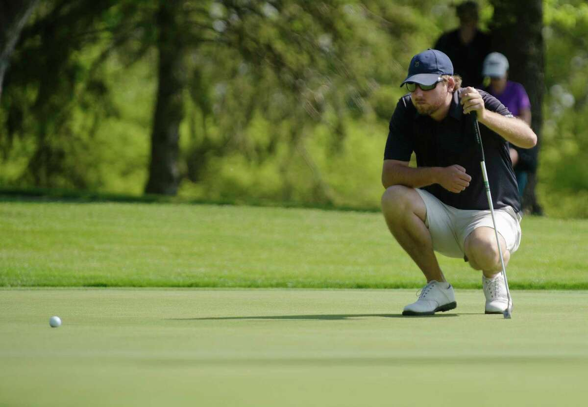 Bryan Bigley of Schenectady lines up his putt on the green during the U.S. Open local qualifier at the Shaker Ridge Country Club on Wednesday, May 17, 2017, in Albany, N.Y. (Paul Buckowski / Times Union)