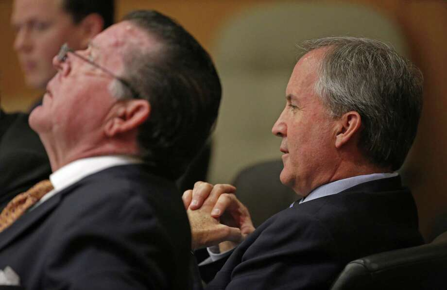 Texas Attorney General Ken Paxton (right) and his attorney Dan Cogdell sit at the defense table during a February pretrial hearing at Collin County Courthouse in McKinney. Photo: Jae S. Lee /Dallas Morning News / The Dallas Morning News