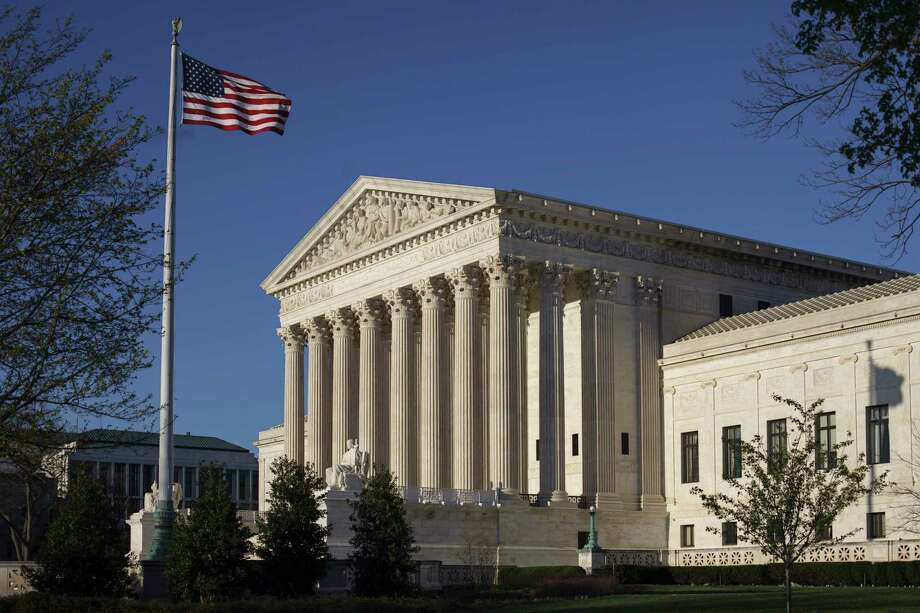 In this photo taken on Tuesday, April 4, 2017, the Supreme Court Building is seen in Washington. A unanimous Supreme Court says religious hospitals don't have to comply with federal laws protecting pension benefits for workers. The justices on Monday ruled in favor of three church-affiliated nonprofit hospital systems being sued for underfunding pension plans covering about 100,000 employees.   (AP Photo/J. Scott Applewhite) Photo: J. Scott Applewhite, STF / Copyright: AP