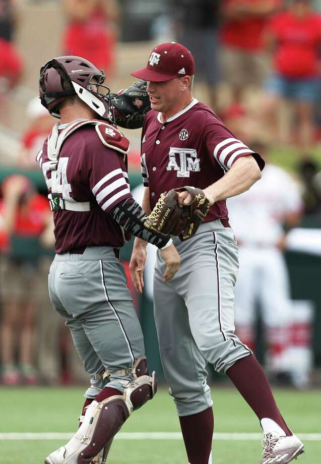 Catcher Cole Bedford, left, joins pitcher Cason Sherrod to begin the celebration after Sherrod closed out Texas A&M's victory by leaving the bases stranded. Photo: Karen Warren, Staff Photographer / 2017 Houston Chronicle