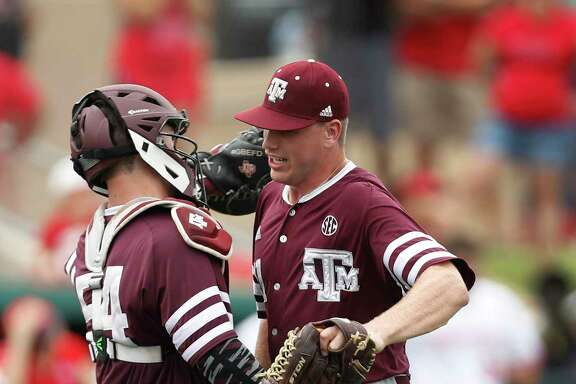 Catcher Cole Bedford, left, joins pitcher Cason Sherrod to begin the celebration after Sherrod closed out Texas A&M's victory by leaving the bases stranded.
