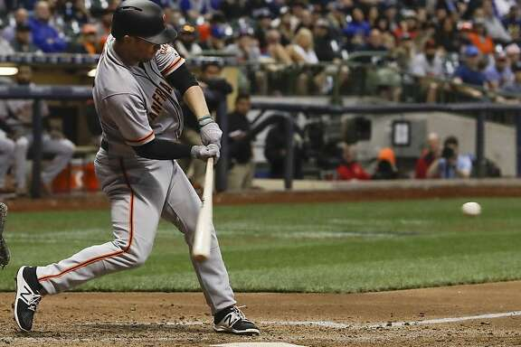 San Francisco Giants' Aaron Hill hits a two-run scoring double during the eighth inning of a baseball game Monday, June 5, 2017, in Milwaukee. (AP Photo/Morry Gash)