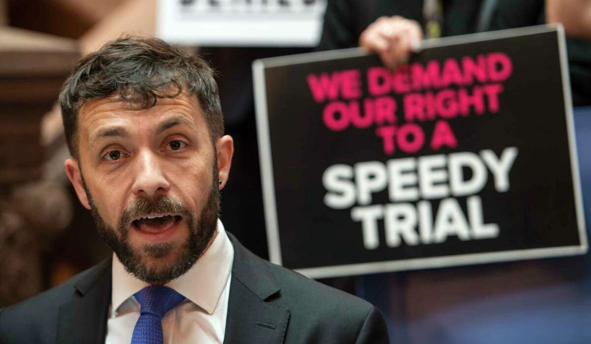 Gabriel Sadegh co-founder and co-executive director of the fatal Center for Health Equity and Justice is joined by a small group of demonstrators urge legislators to support speedy trial reform during a gathering Monday June 5, 2017 at the State Capitol in Albany, N.Y. (Skip Dickstein/Times Union)