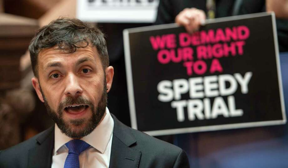 Gabriel Sadegh co-founder and co-executive director of the fatal Center for Health Equity and Justice is joined by a small group of demonstrators urge legislators to support speedy trial reform during a gathering Monday June 5, 2017 at the State Capitol in Albany, N.Y.  (Skip Dickstein/Times Union) Photo: SKIP DICKSTEIN / 40040683A