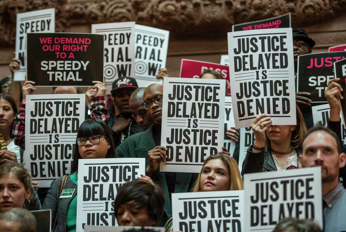 A small group of demonstrators urge legislators to support speedy trial reform during a gathering Monday June 5, 2017 at the State Capitol in Albany, N.Y. (Skip Dickstein/Times Union)