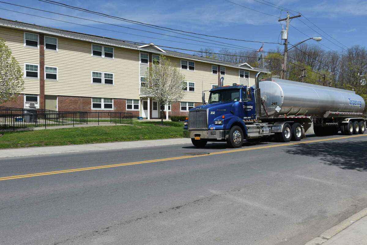 A tractor-trailer heads south on South Pearl St. past the Ezra Prentice homes on Monday, April 24, 2017, in Albany, N.Y. (Will Waldron/Times Union)