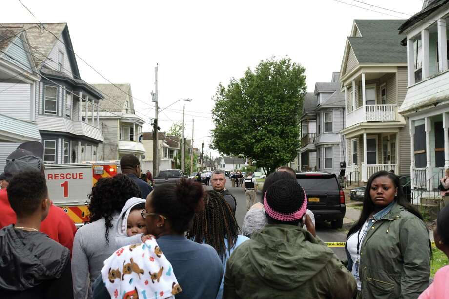 People gather on Mumford Street near where a man was shot by police in June 2017 in Schenectady.  (Paul Buckowski / Times Union) / 40040690A
