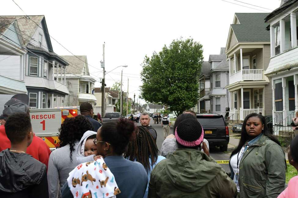 People gather on Mumford Street near where a man was shot by police in June 2017 in Schenectady. (Paul Buckowski / Times Union)